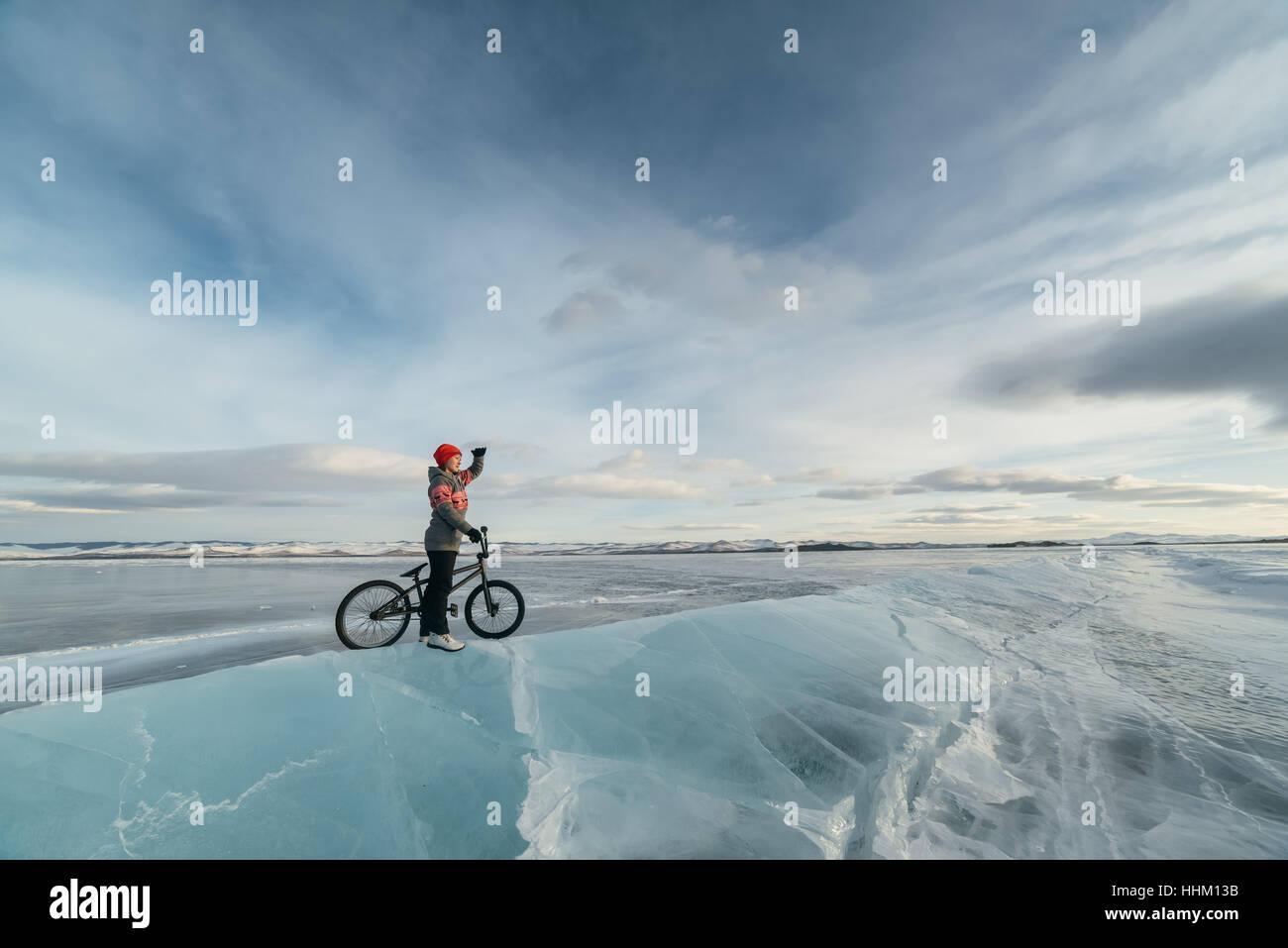 Girl on a bmx on ice. - Stock Image