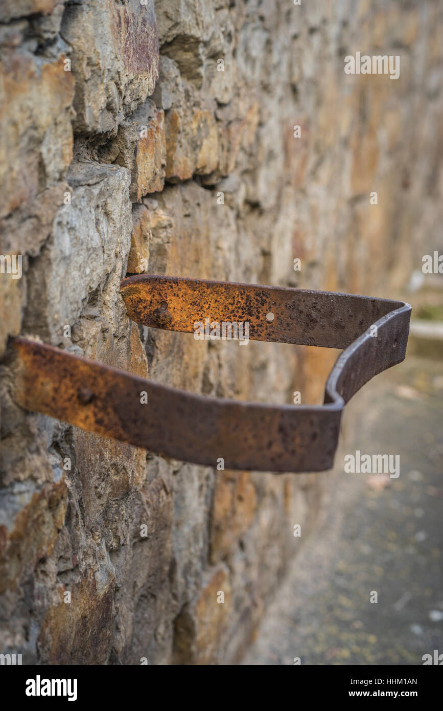 Architectural steel object hanging out of a wall - Stock Image