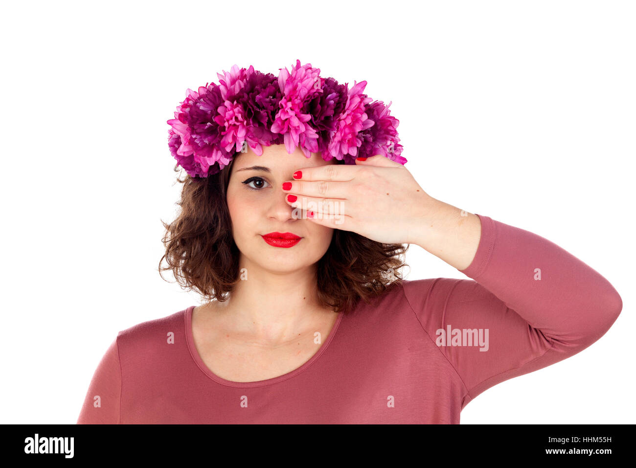 Beautiful girl with pink flowers crown covering one eye isolated on white background Stock Photo