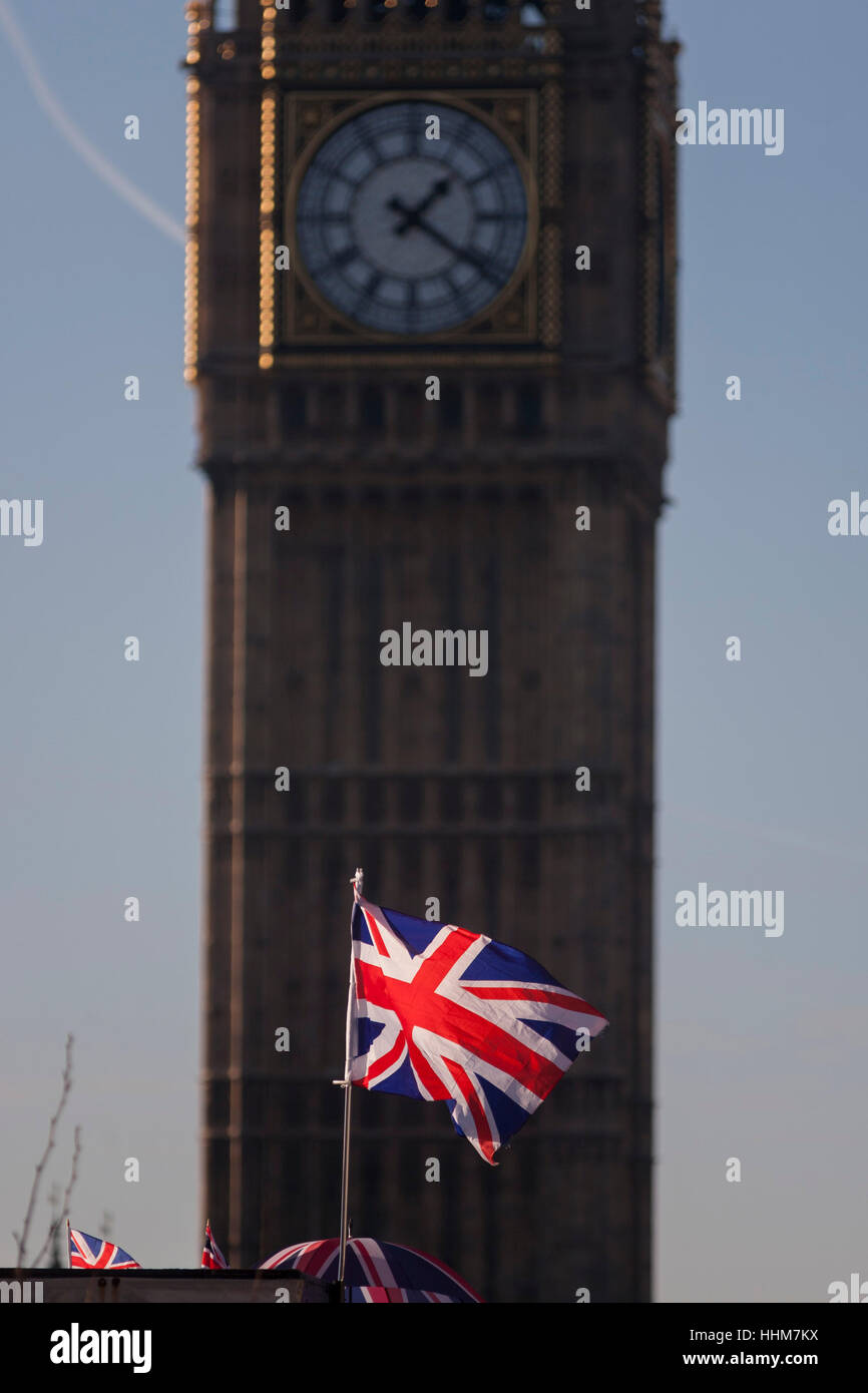 A Union Jack flag and in the background, the Elizabeth Tower of the British parliament, on 17th January 2017, in - Stock Image