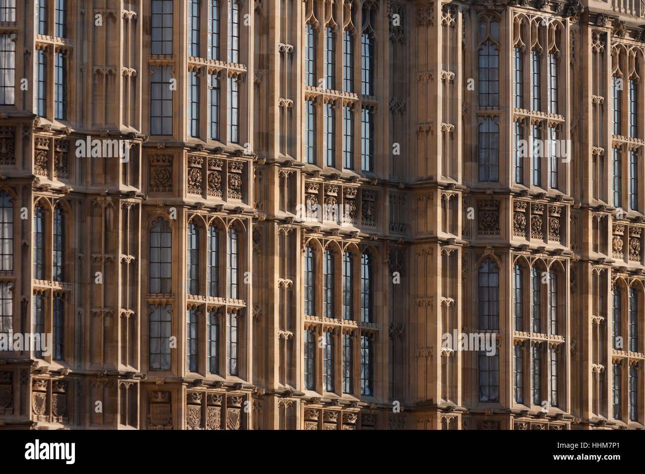 Exterior of windows and architecture of the Palace of Westinster, the seat of the British parliament and where its - Stock Image