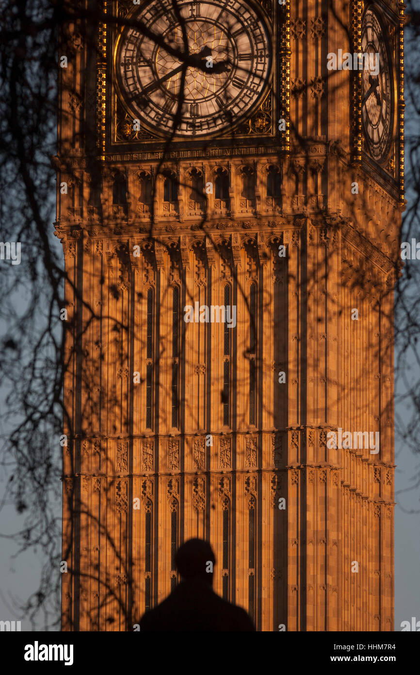 The silhouetted statue of Sir Robert Peel and the clockface containing the Big Ben bell in the Elizabeth Tower of - Stock Image