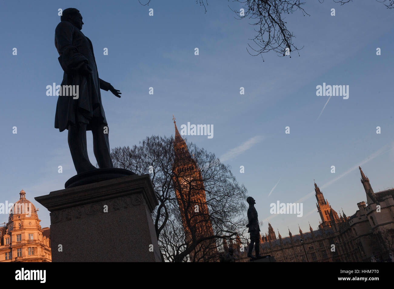 A silhouetted statues of Lord Palmerston and Jan Smuts, on 17th January 2017, in Parliament Square, Westminster, - Stock Image