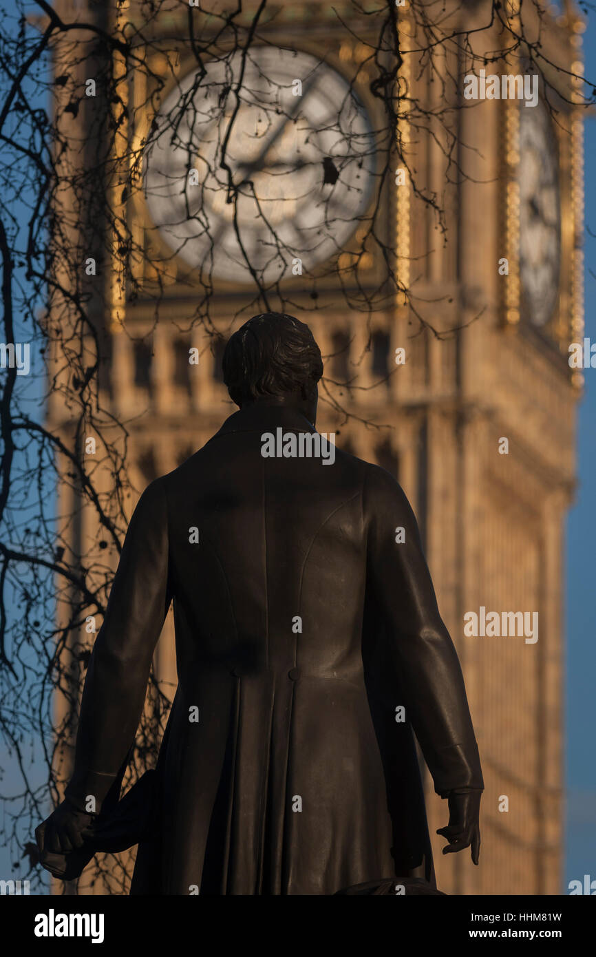 The statue of Sir Robert Peel and the Elizabeth Tower of the British Houses of Parliament, on 17th January 2017, - Stock Image