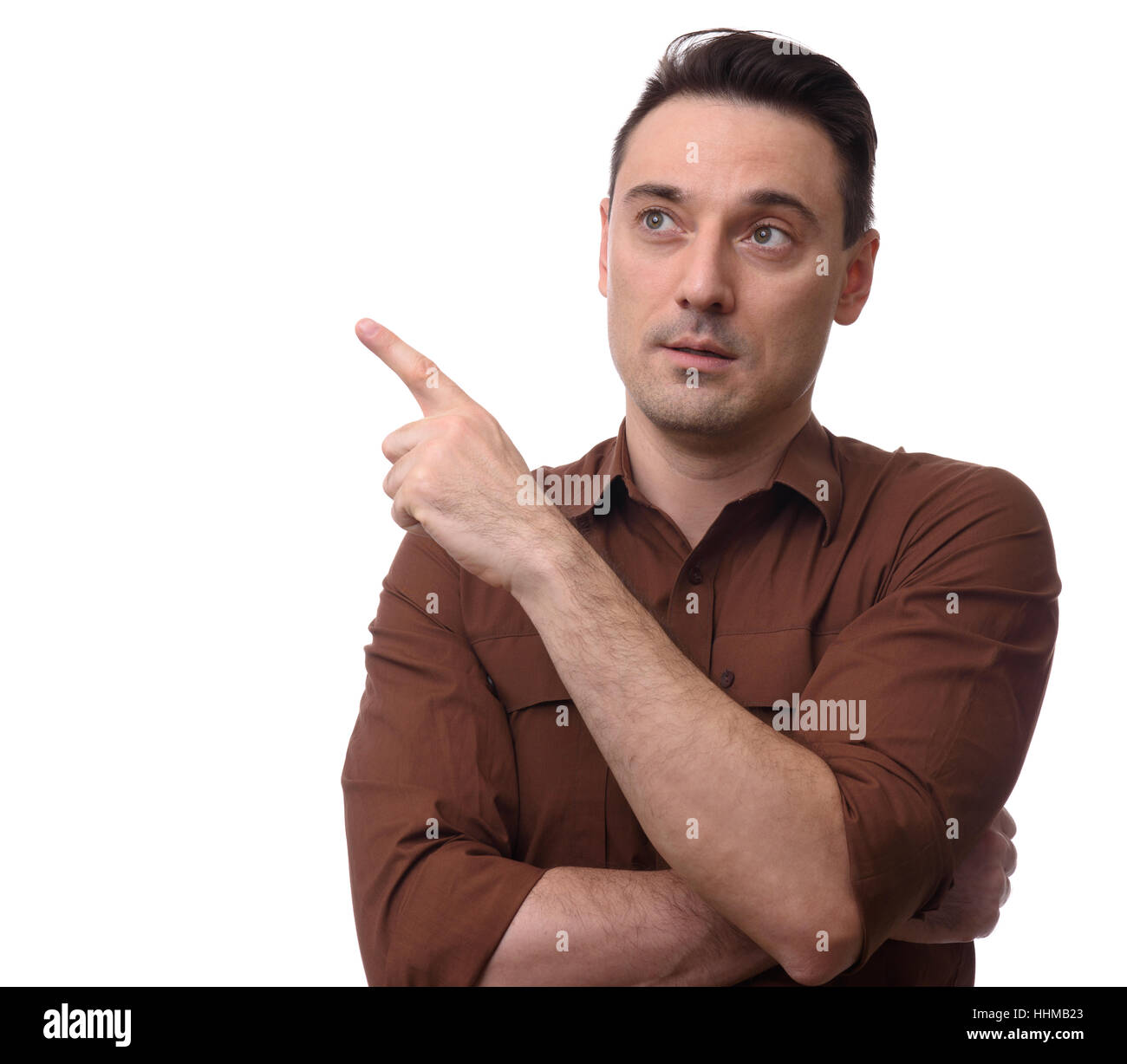 smiling man pointing finger to copy space. Isolated on white background - Stock Image