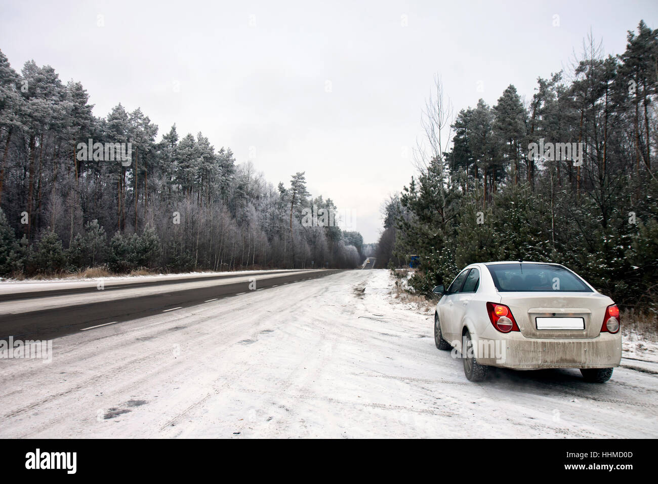 car beside the winter road Stock Photo