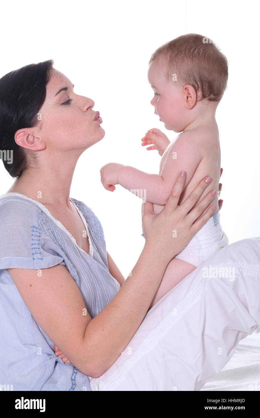 woman, baby, mother, mom, ma, mommy, smack, kissing, wife, partner, spouse, - Stock Image