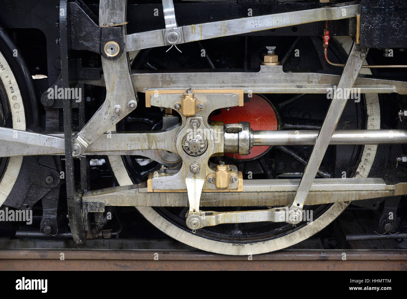 Piston and Steel Wheel on Steam Train Running on the 'Train des Pignes' line from Nice to Digne, at Annot, - Stock Image