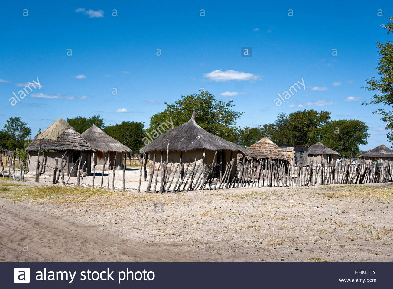 Round huts in a village, Botswana - Stock Image