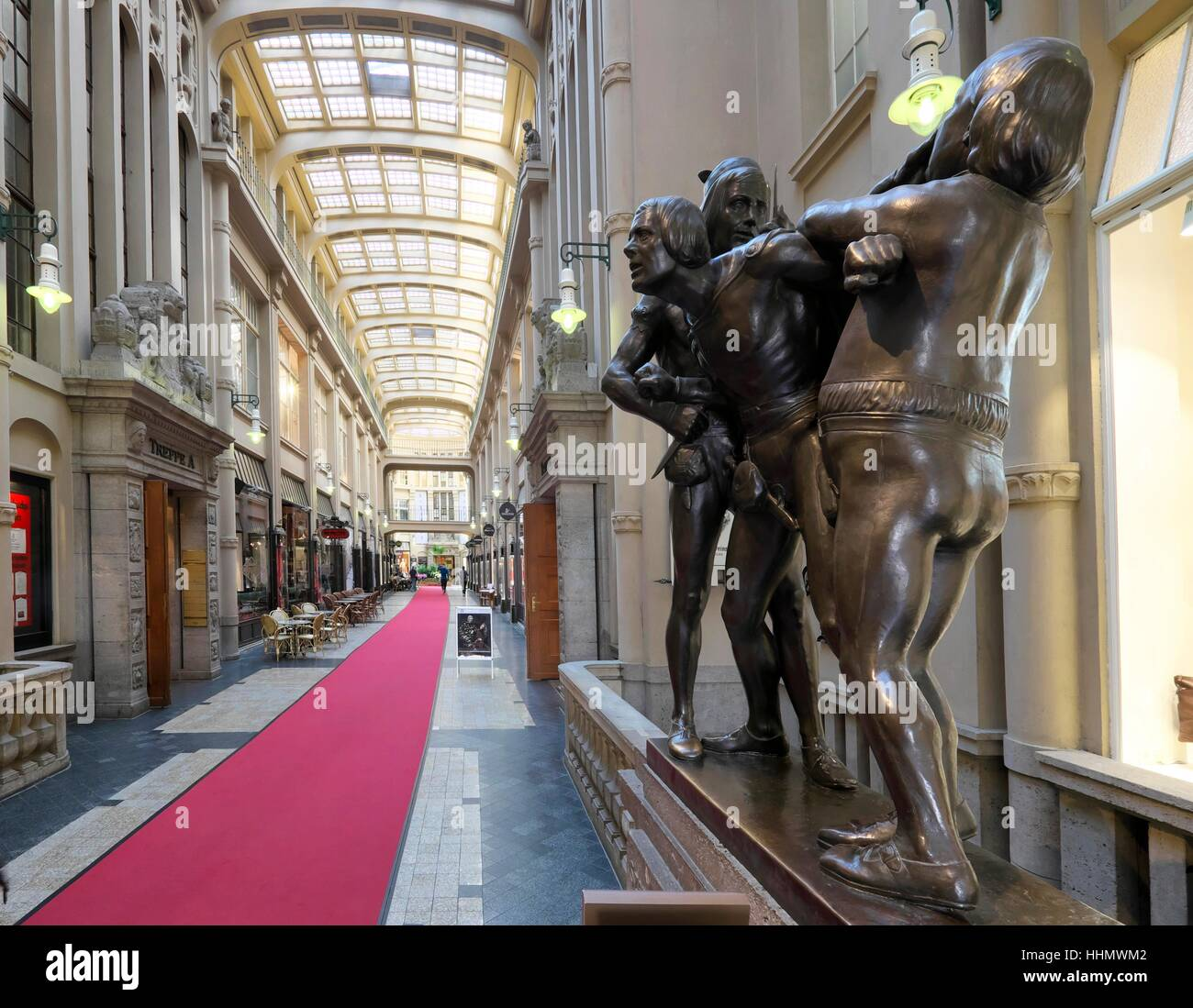 Figure group, scene of Auerbachs Keller from Goethe's Faust, Mädlerpassage, Leipzig, Saxony, Germany - Stock Image