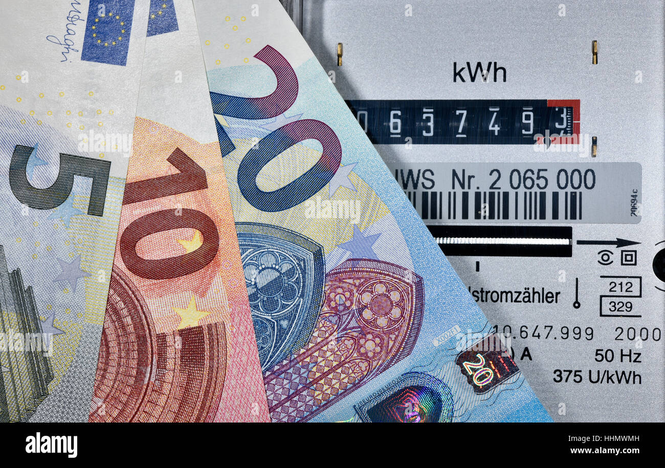 Image symbolic of energy costs, electricity meter with Euro banknotes fanned out - Stock Image
