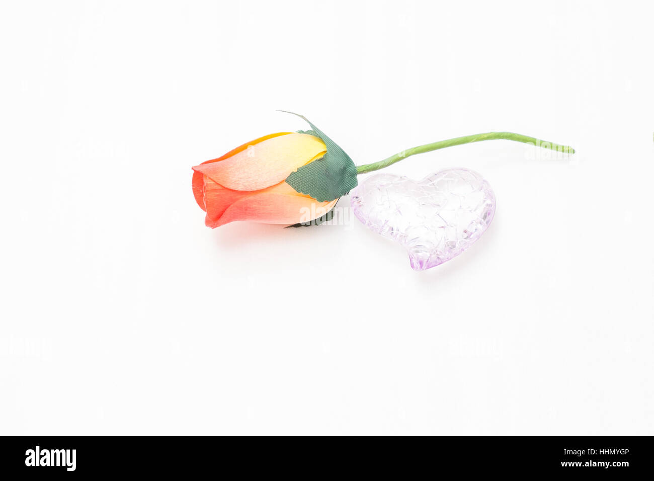 rose by a broken to seek reconciliation day valentine heart - Stock Image