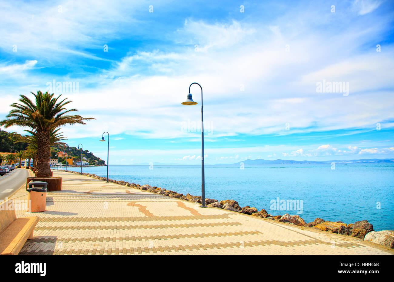 Promenade seafront or esplanade in Porto Santo Stefano harbor, Monte Argentario, Tuscany, Italy. - Stock Image