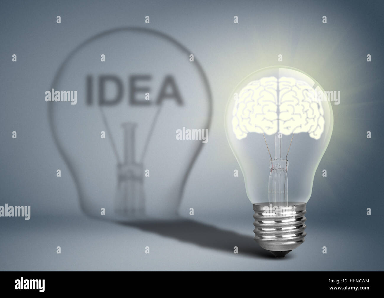 Bulb with brain and shadow, thinking concept - Stock Image