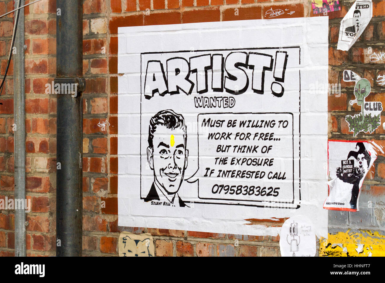 Graffiti and murals in Manchester city's northern quarter Stock Photo