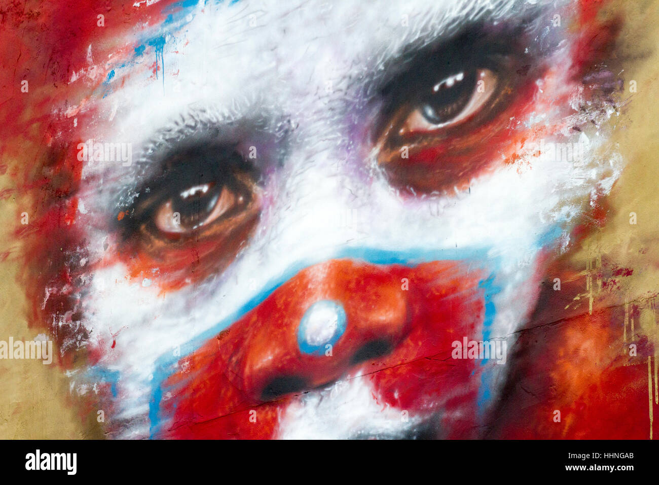 African style painted voodoo red-faced scary clown graffiti, Manchester, UK - Stock Image