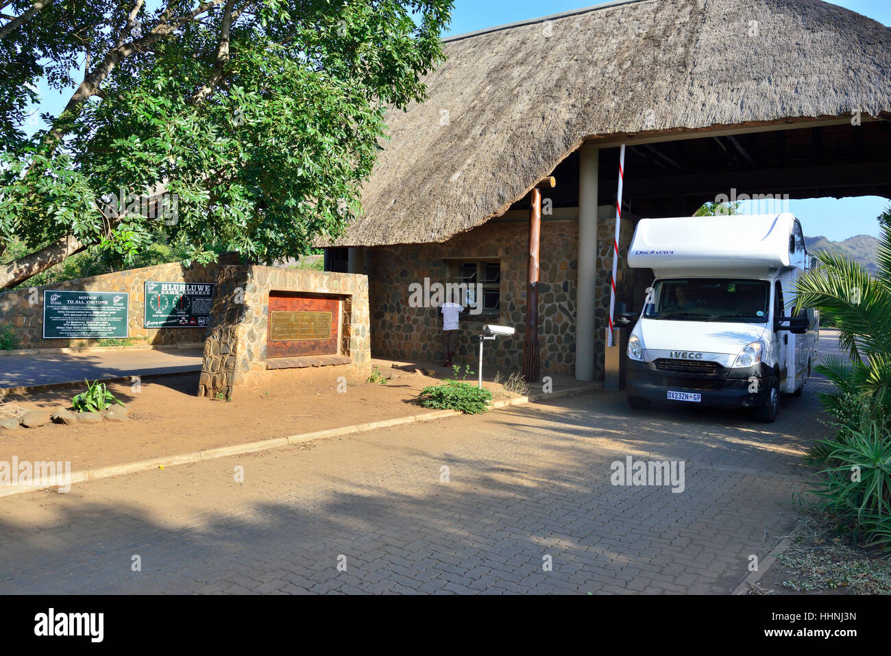 Motorhome checking out of the security gates  to the entrance to Hluhluwe-Imfolozi Park south africa - Stock Image