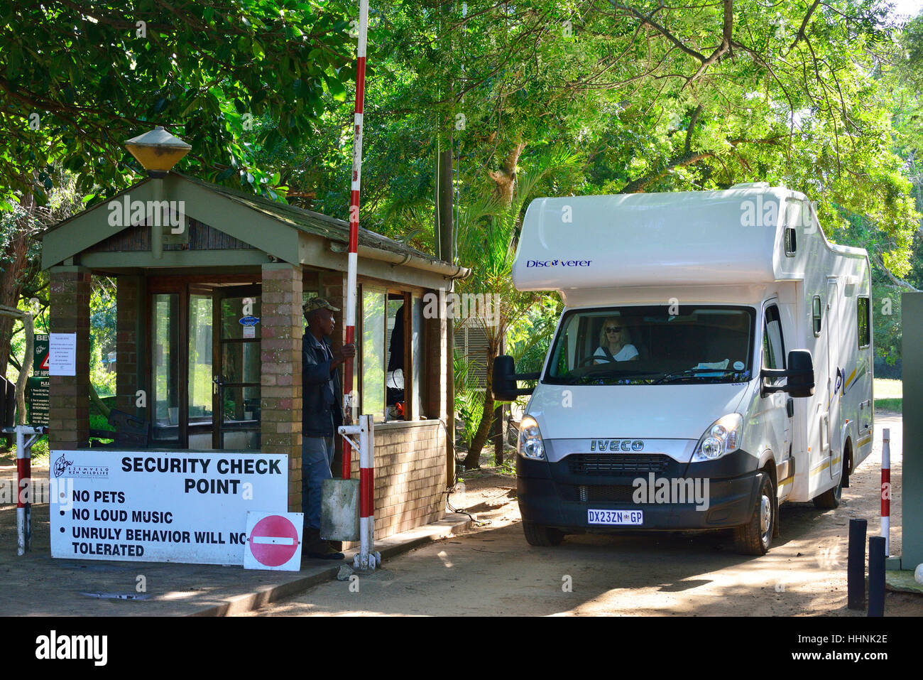 Motorhome checking out of the security gates  to the entrance to Sugar Loaf Campsite . St.Lucia .  Isimangaliso - Stock Image