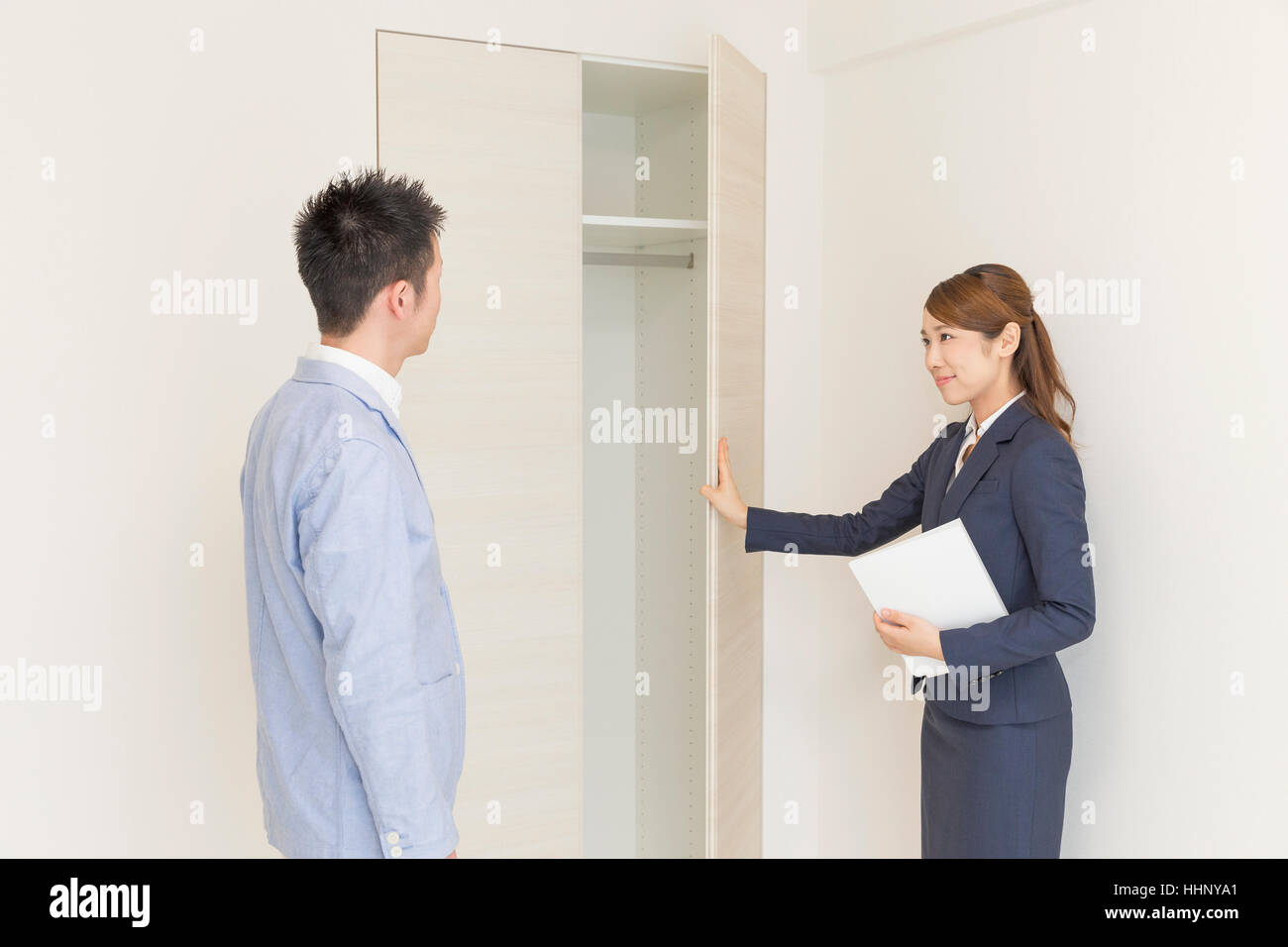 Real Estate Agent Showing Room to Buyer - Stock Image