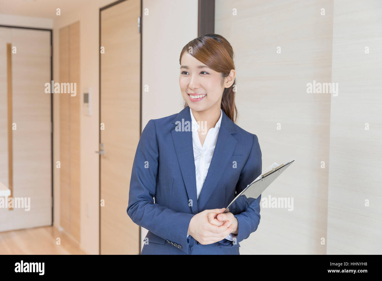 Woman Smiling to Buyer - Stock Image