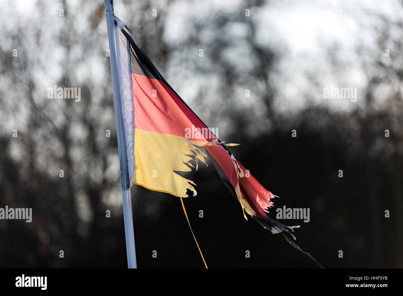 Flag Germany, flag of Germany, torn apart, torn, broken. Symbol, symbolic, power, state, crisis. Power crisis, black - Stock Image