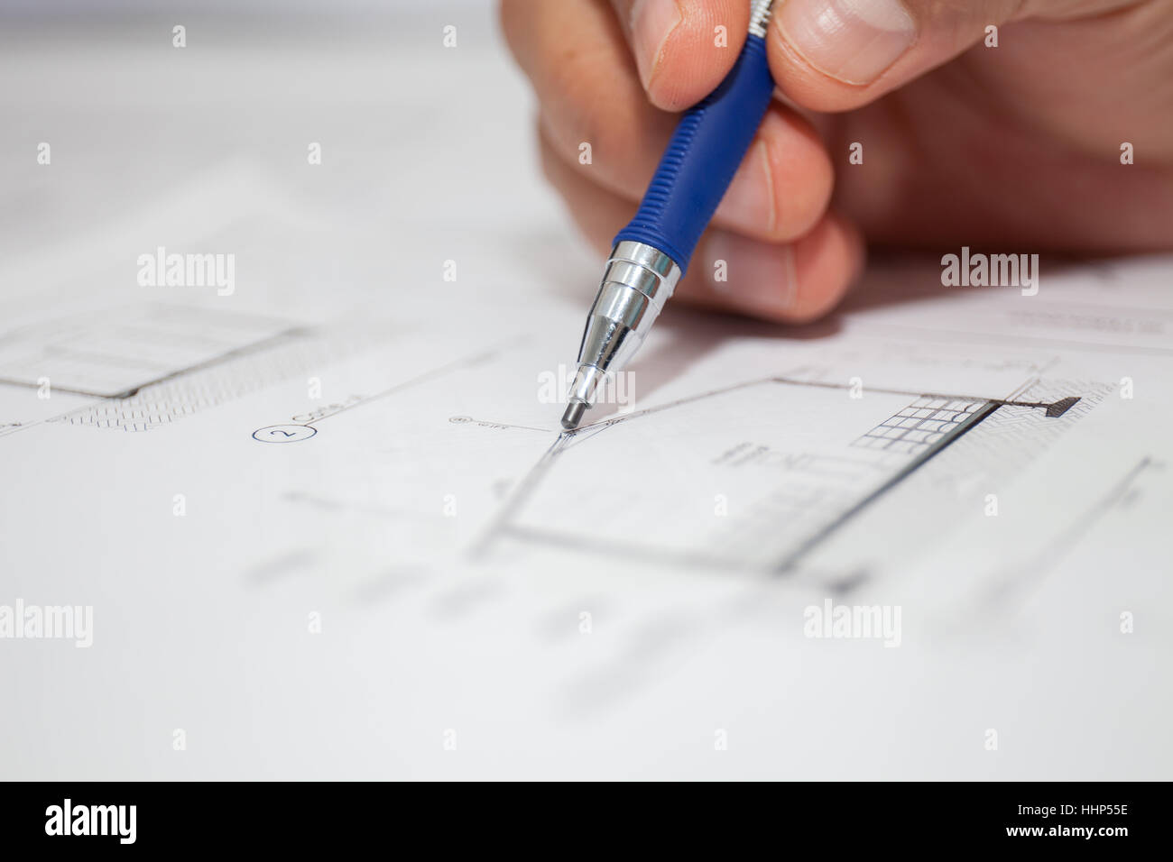 construction engineer draws pencil - Stock Image