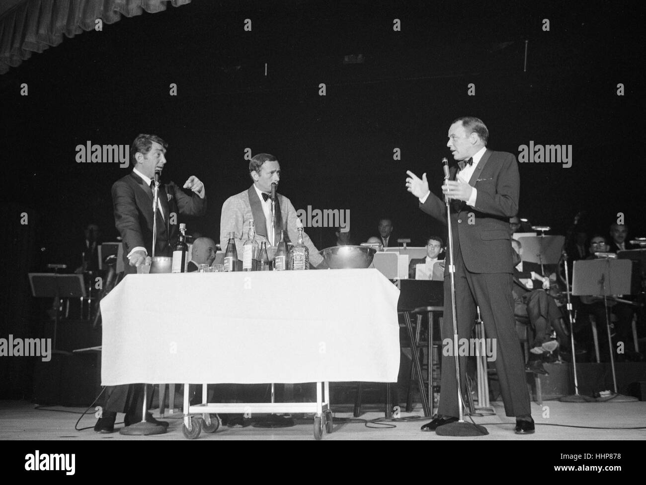 Dean Martin, Joey Bishop, and Frank Sinatra on stage - Stock Image