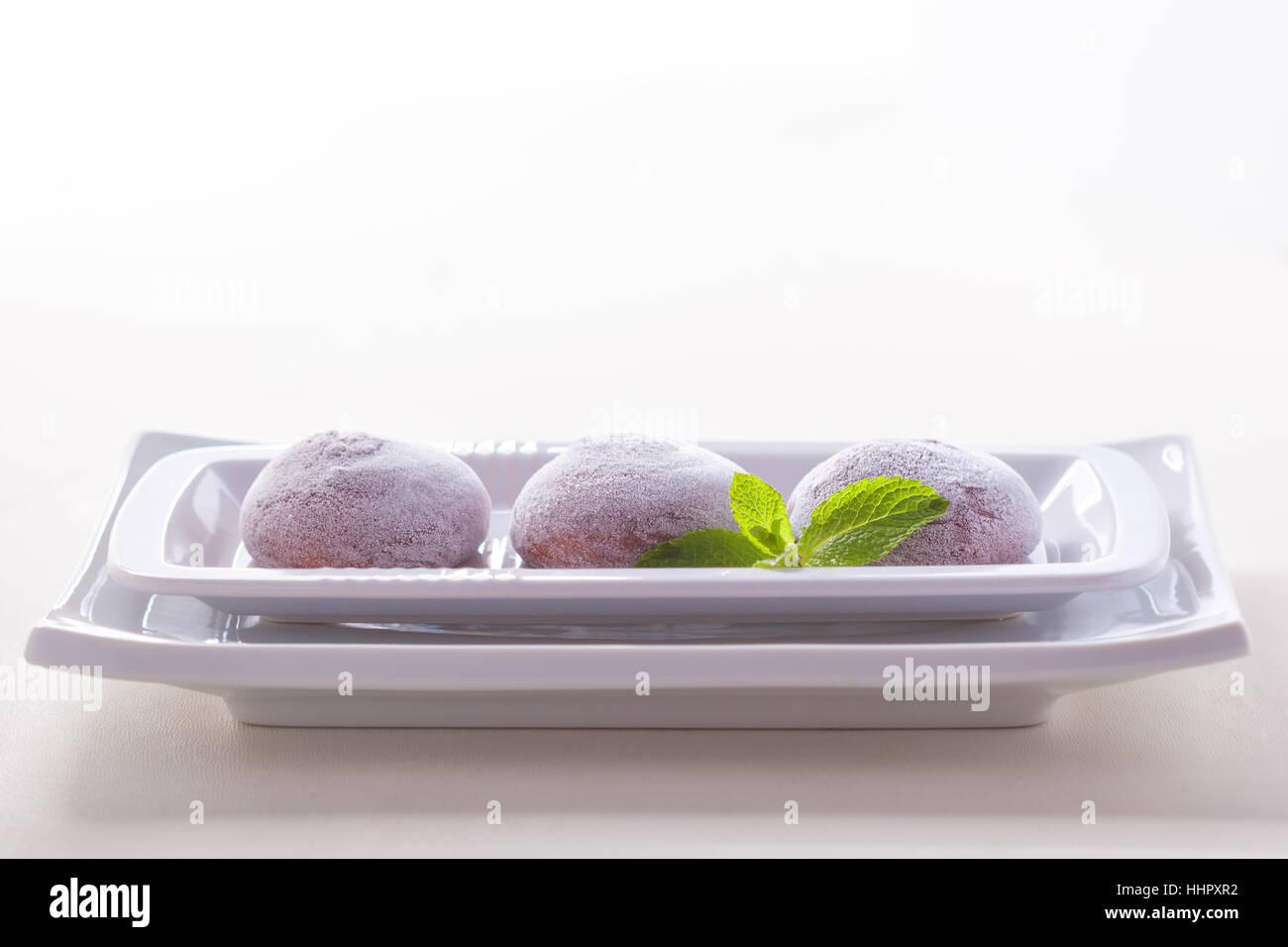 Chocolate coconut mochi ice cream on white background - Stock Image