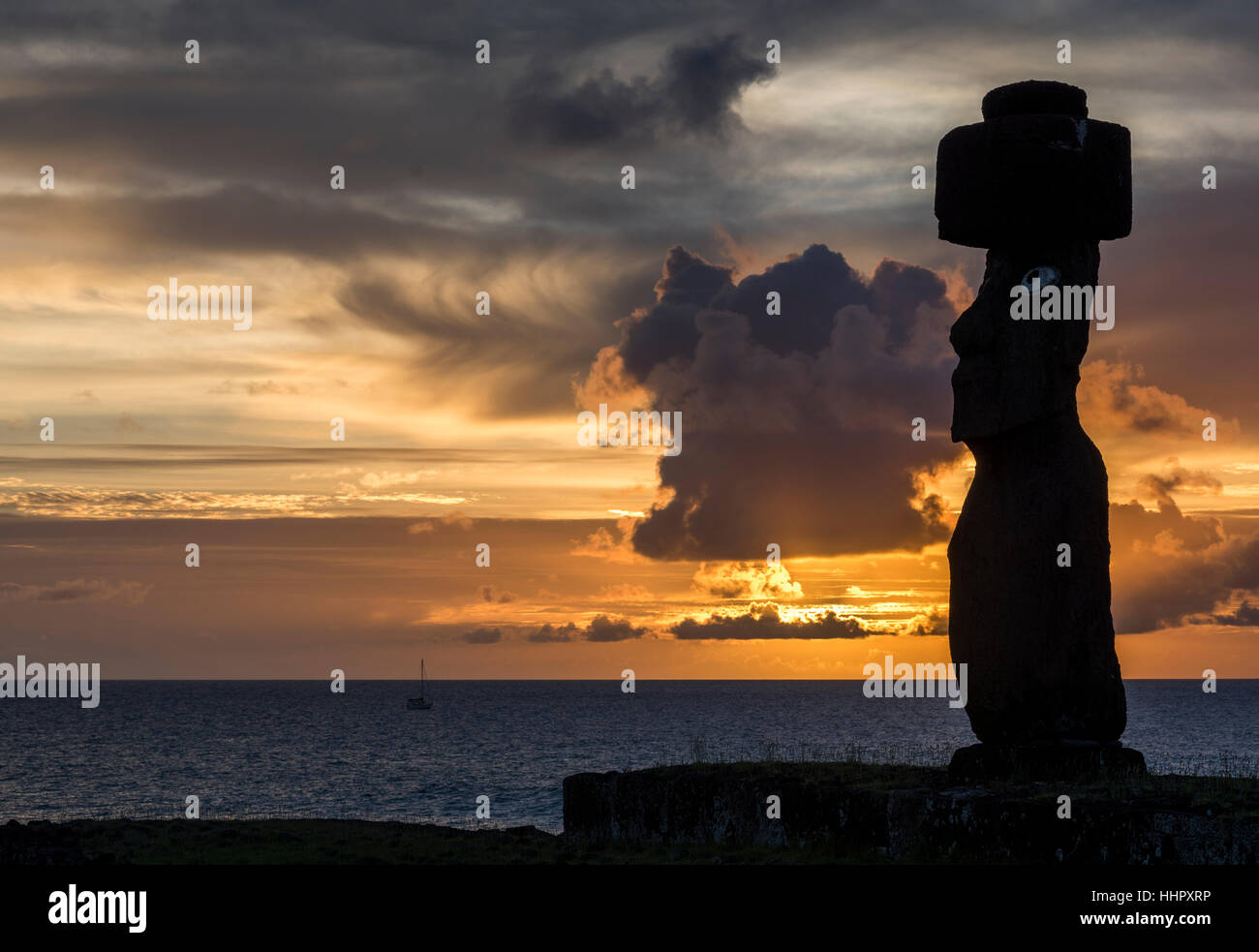 sunset at Ahu Ko Te Riku in Easter Island .Hanga Roa.Ko Te Riku is the only Moai on the island with restored eyes. - Stock Image