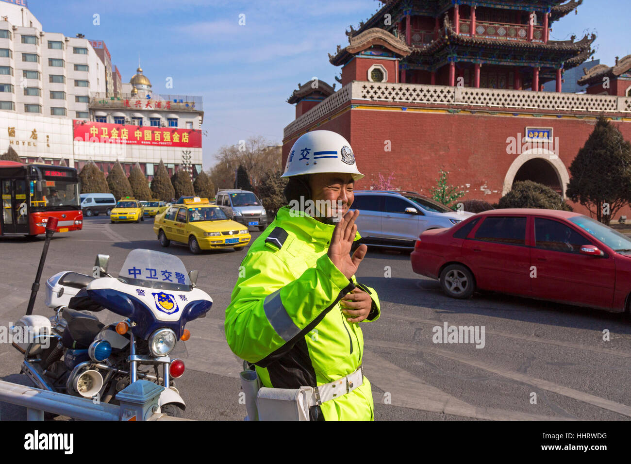 Traffic police at Drum Tower junction, Zhongwei, Ningxia province, China - Stock Image