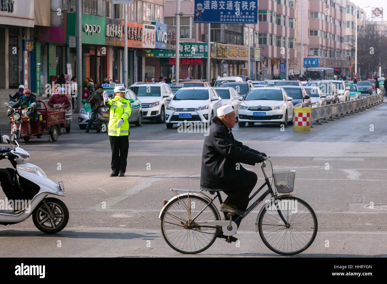 Police controling traffic at road junction, Wuzhong, Ningxia province, China - Stock Image