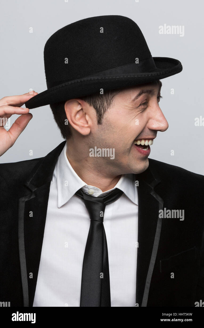 Portrait of man wearing a black bowler hat and a black suit - Stock Image b62a8433997