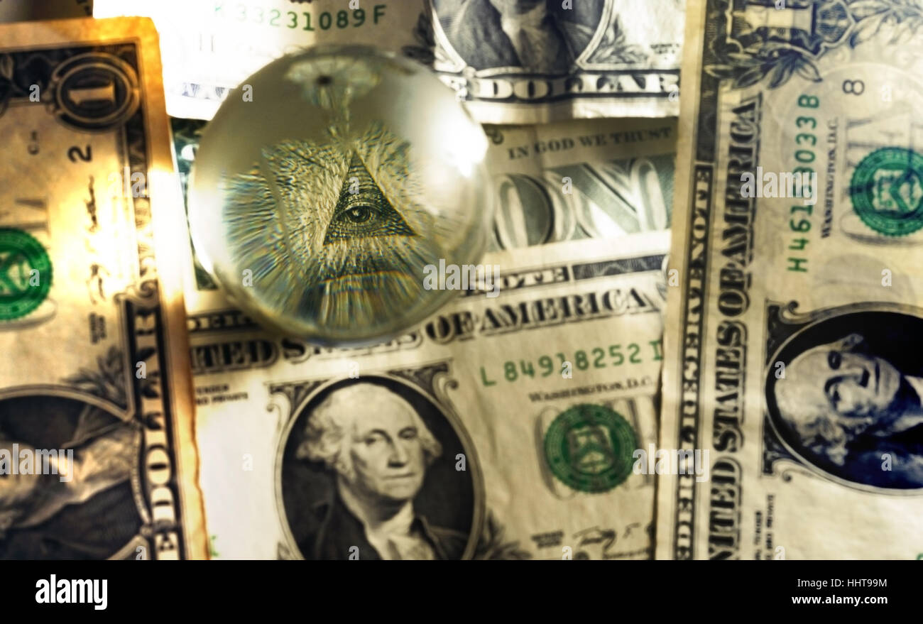 Eye of Providence all-seeing eye from US one dollar bill under glass globe, illuminati symbol in sepia tones - Stock Image