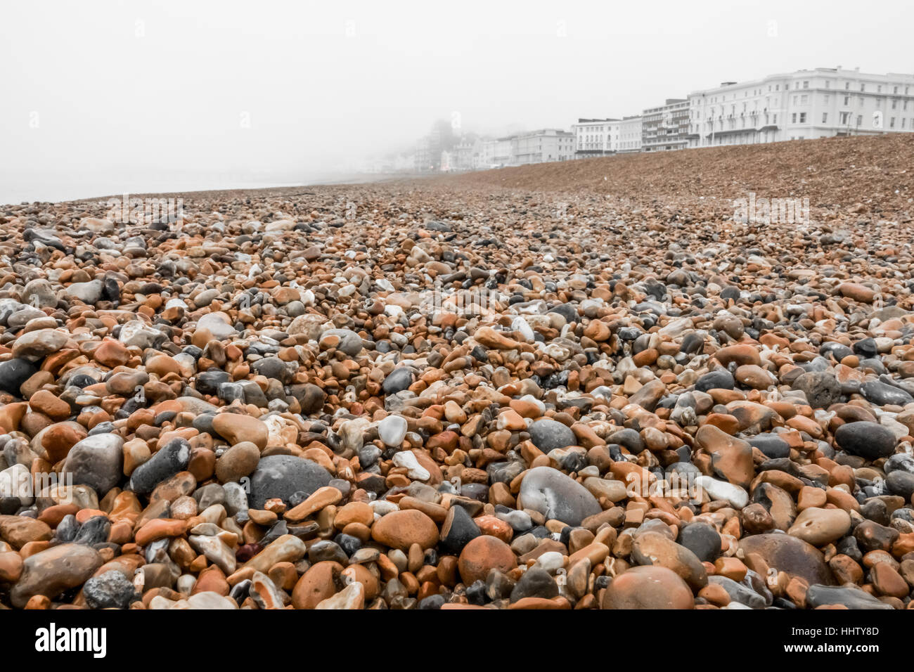 Hastings stony beach on a cold winter day, England, UK - Stock Image