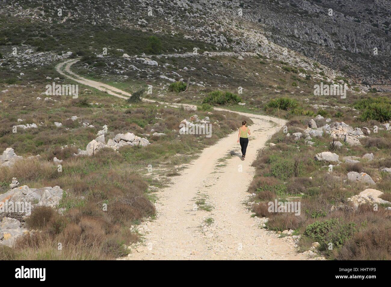 Mountain path in carboniferous limestone landscape, near Benimaurell, Vall de Laguar, Marina Alta, Alicante province, Stock Photo