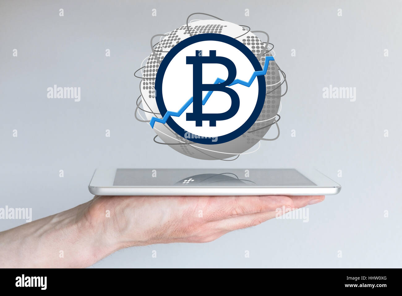Increasing of global bitcoin currency exchange rate concept with hand holding tablet - Stock Image