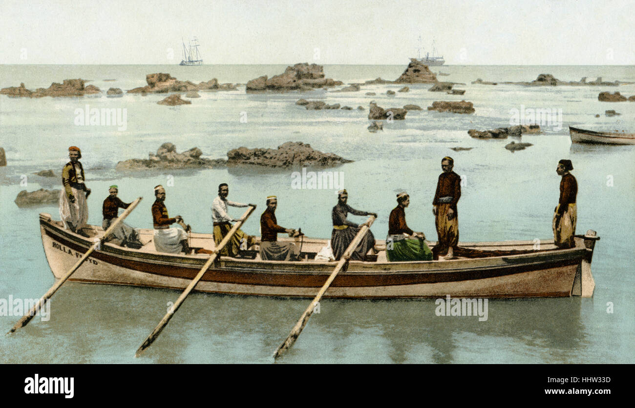 Boat and boatmen from Jaffa in the Mediterranean sea - Stock Image