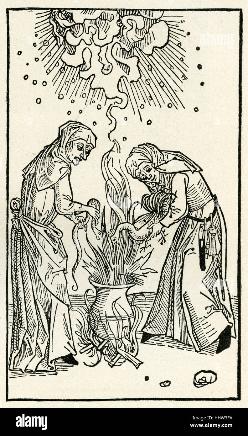 Witches brewing a spell in a cauldron, woodcut c. 1508 from 'De Lamiis et Pythonicis Mulieribus', tract - Stock Image