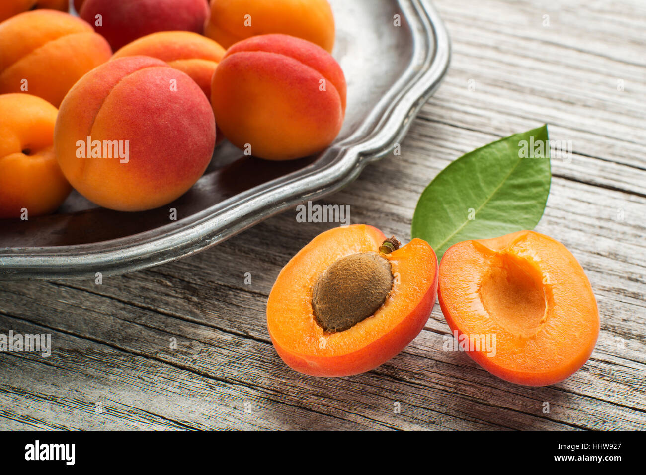 Fresh Apricots on wooden table close up - Stock Image