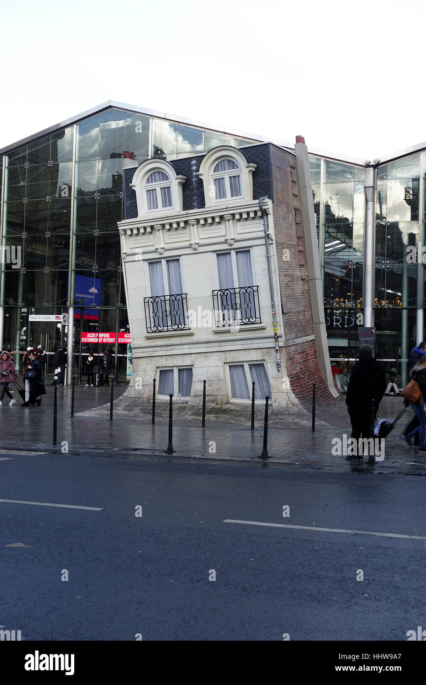 The 'Maison Fond' installation by Argentinian artist Leandro Erlich, held in front of the 'Gare du Nord' - Stock Image