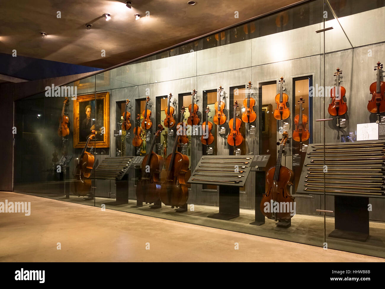 Old violins on display in Interior musée de la cite, museum, Cite de la musique, Paris, France. - Stock Image