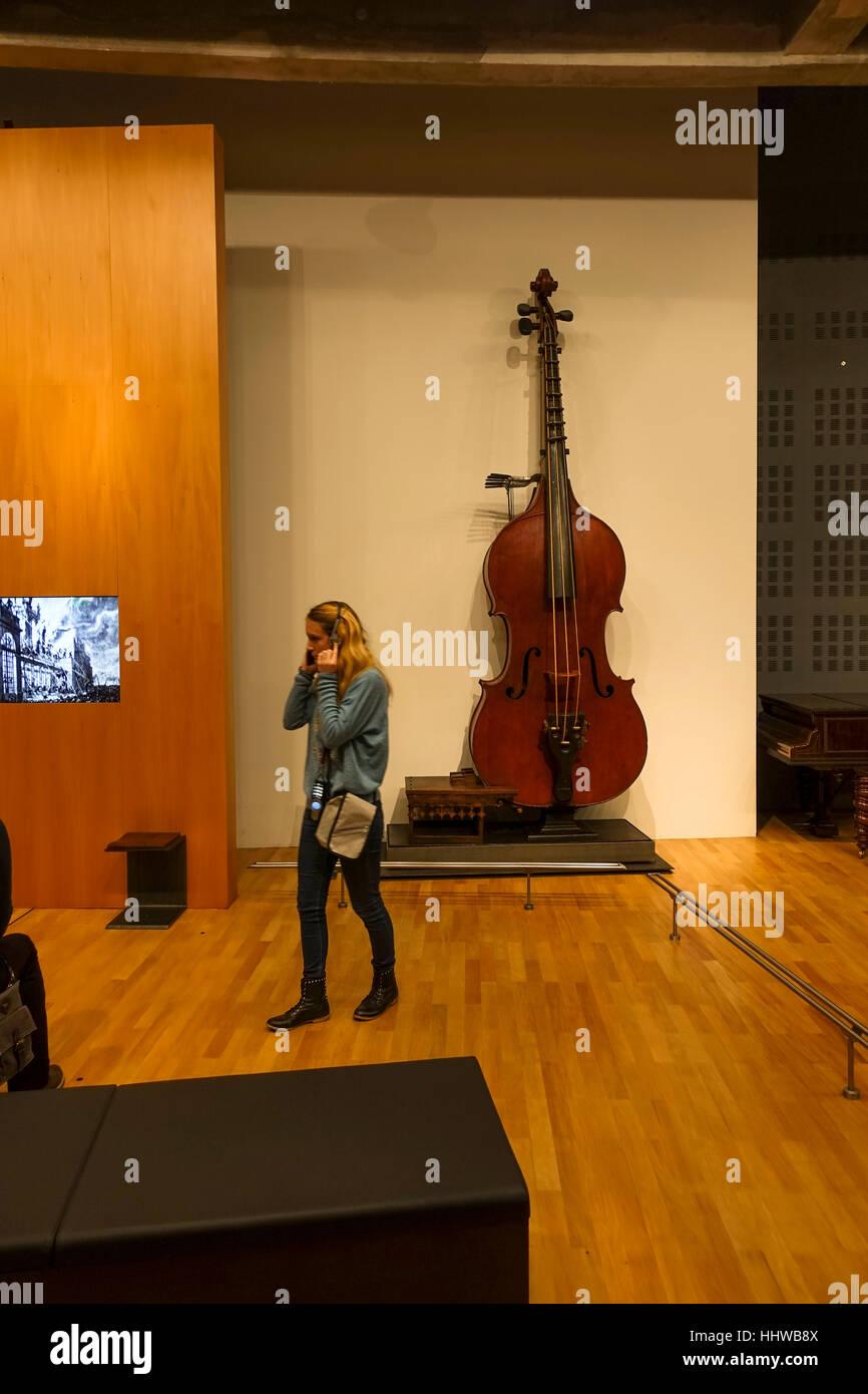 Large double bass in Interior musée de la cite, museum, Cite de la musique, Paris, France. - Stock Image