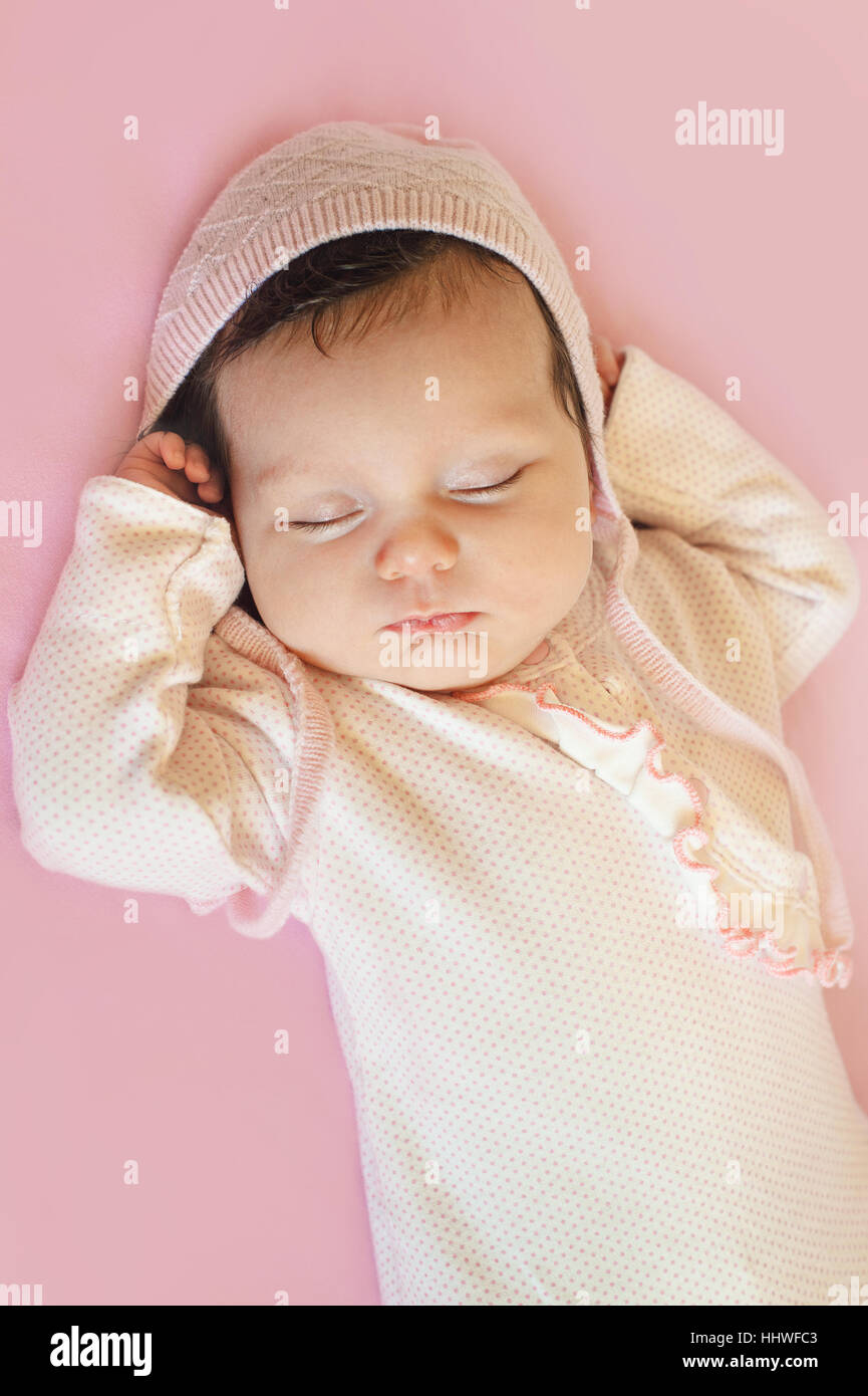 Newborn sweet cute baby girl face sleep
