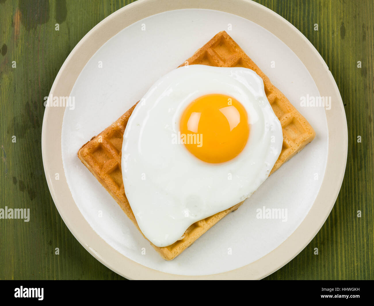 Breakfast Food of Fried Egg on a Waffle Stock Photo