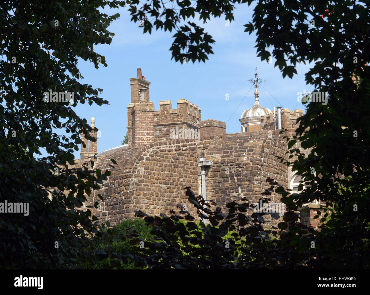 Rear view of Walmer Castle framed by the surrounding trees in the gardens - Stock Image
