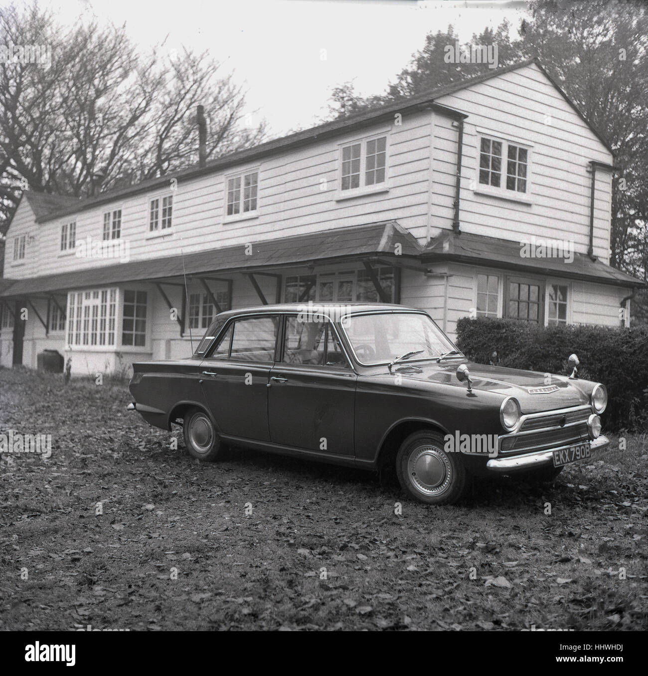 1960s, historical, Ford Cortina car with registration 'EKX 790B' parked outside large house, England, UK. Stock Photo