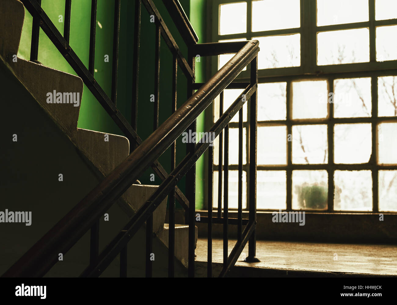 Details of an old building stairways and window, retro look. - Stock Image