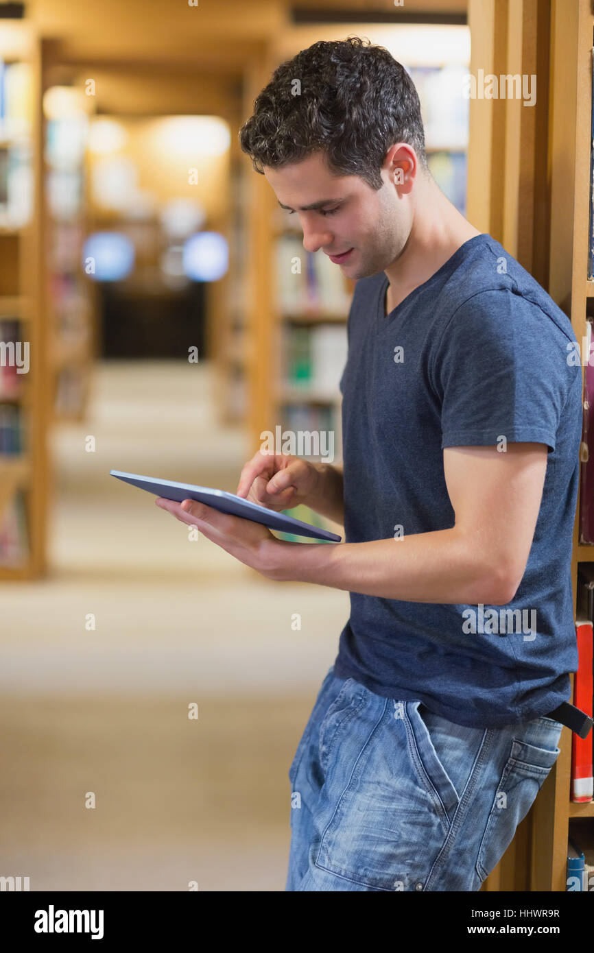 Smiling student with tablet pc in college stock photo: 58896865.