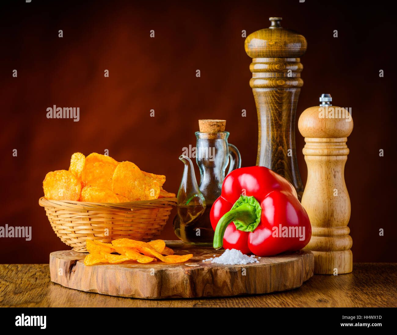 Red Pepper with Potato-Chips and Ingredients in Still Life - Stock Image