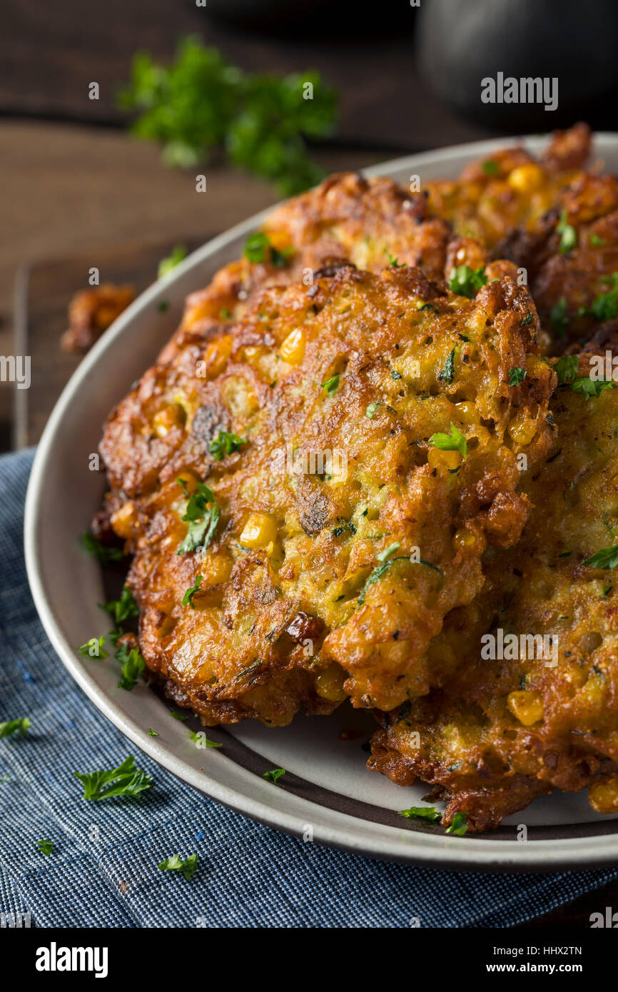 Homemade Fried Corn Fritter with Zucchini and Parsley - Stock Image